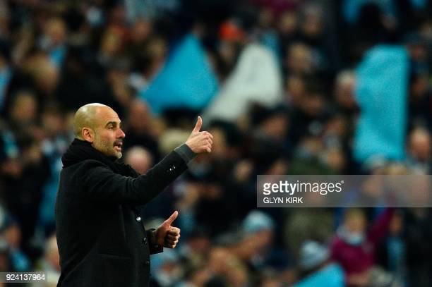 Manchester City's Spanish manager Pep Guardiola gestures on the touchline during the English League Cup final football match between Manchester City...