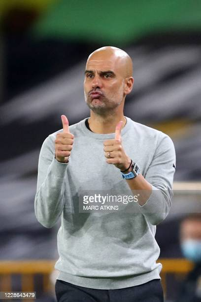 Manchester City's Spanish manager Pep Guardiola gestures to his players from the sidelines following their second goal during the English Premier...