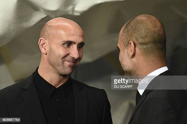 Manchester City's Spanish manager Pep Guardiola greets Moenchengladbach's head coach Andre Schubert before kick off of the UEFA Champions League...