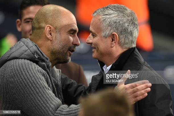 Manchester City's Spanish manager Pep Guardiola greets Manchester United's Portuguese manager Jose Mourinho before the English Premier League...