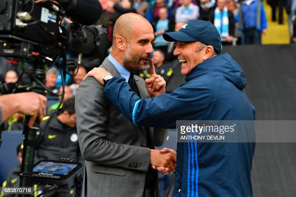 Manchester City's Spanish manager Pep Guardiola greets West Bromwich Albion's Welsh head coach Tony Pulis during the English Premier League football...