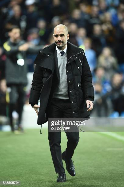 Manchester City's Spanish manager Pep Guardiola leaves the pitch at halftime during the UEFA Champions League Round of 16 firstleg football match...