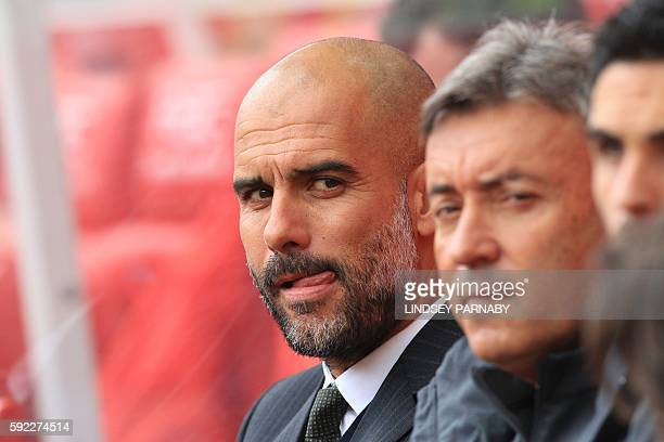 Manchester City's Spanish manager Pep Guardiola looks on ahead of the English Premier League football match between Stoke City and Manchester City at...
