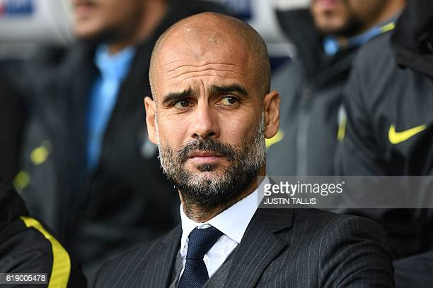 Manchester City's Spanish manager Pep Guardiola looks on ahead of the English Premier League football match between West Bromwich Albion and...