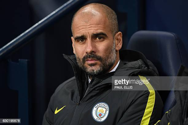 Manchester City's Spanish manager Pep Guardiola looks on ahead of the English Premier League football match between Manchester City and Arsenal at...