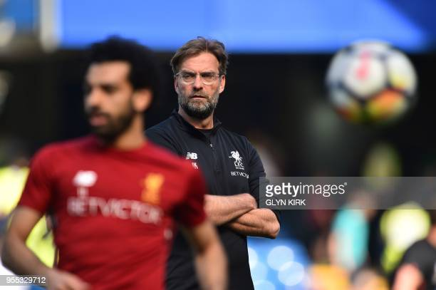 Manchester City's Spanish manager Pep Guardiola looks on as Liverpool's Egyptian midfielder Mohamed Salah walks before the English Premier League...