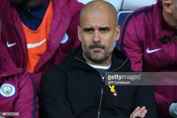 Manchester City's Spanish manager Pep Guardiola looks on before the English Premier League football match between West Bromwich Albion and Manchester...