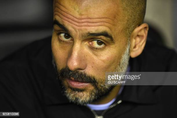Manchester City's Spanish manager Pep Guardiola looks on before the English FA Cup fifth round football match between Wigan Athletic and Manchester...