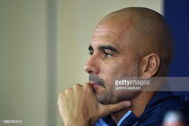 Manchester City's Spanish manager Pep Guardiola looks on during a press conference of Manchester City at the Metallist stadium in Kharkiv on October...