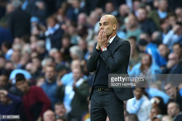 Manchester City's Spanish manager Pep Guardiola looks on during the English Premier League football match between Manchester City and Everton at the...