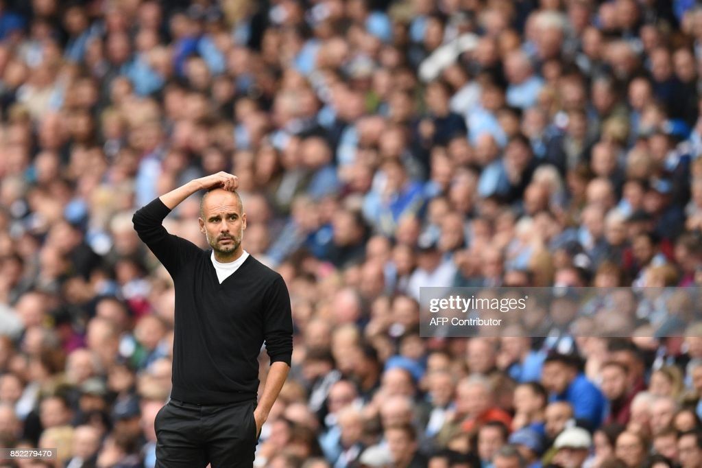 Manchester City's Spanish manager Pep Guardiola looks on during the English Premier League football match between Manchester City and Crystal Palace at the Etihad Stadium in Manchester, north west England, on September 23, 2017. / AFP PHOTO / Oli SCARFF / RESTRICTED TO EDITORIAL USE. No use with unauthorized audio, video, data, fixture lists, club/league logos or 'live' services. Online in-match use limited to 75 images, no video emulation. No use in betting, games or single club/league/player publications. /