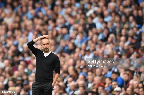 Manchester City's Spanish manager Pep Guardiola looks on during the English Premier League football match between Manchester City and Crystal Palace...