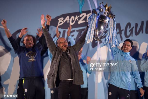 Manchester City's Spanish manager Pep Guardiola Manchester City assistant coach Mikel Arteta and Manchester City's Belgian defender Vincent Kompany...