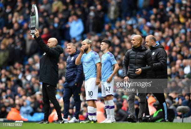 Manchester City's Spanish manager Pep Guardiola prepares to use his substitute players Sergio Aguero and Phil Foden during the English Premier League...