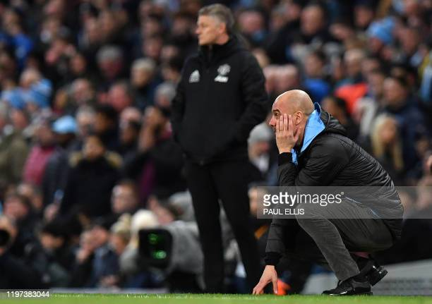 Manchester City's Spanish manager Pep Guardiola reacts after a missed oppportunity to score during the English League Cup semifinal second leg...