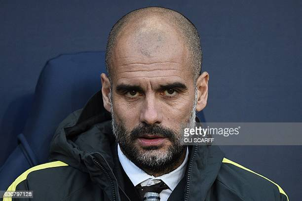 Manchester City's Spanish manager Pep Guardiola reacts ahead of the English Premier League football match between Manchester City and Burnley at the...