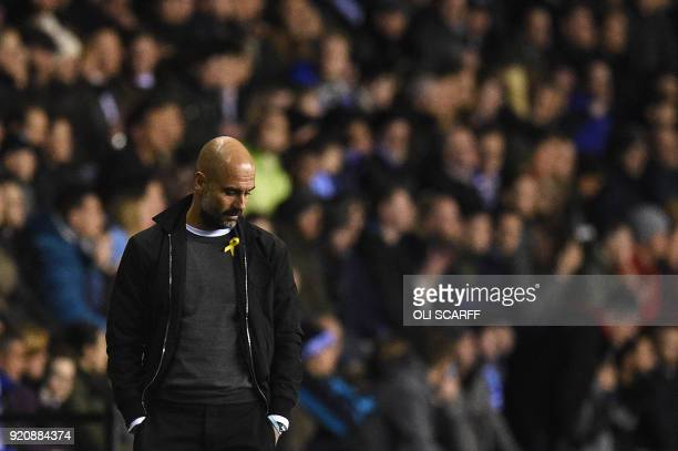 Manchester City's Spanish manager Pep Guardiola reacts during the English FA Cup fifth round football match between Wigan Athletic and Manchester...