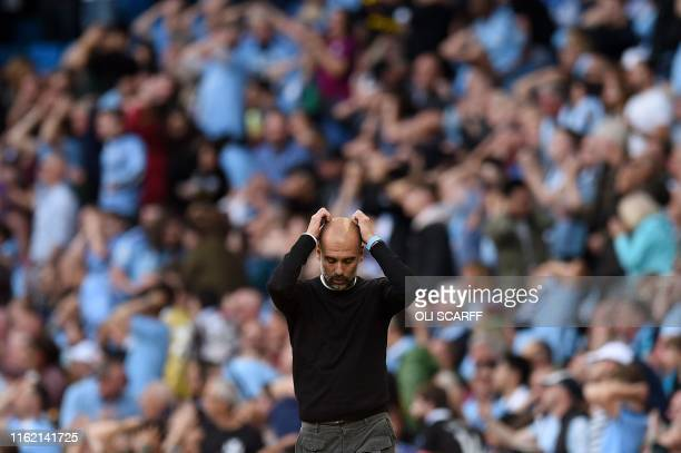 Manchester City's Spanish manager Pep Guardiola reacts during the English Premier League football match between Manchester City and Tottenham Hotspur...