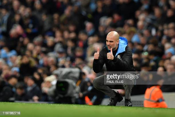 Manchester City's Spanish manager Pep Guardiola reacts during the English League Cup semifinal second leg football match between Manchester City and...