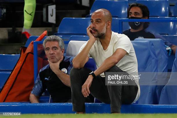 Manchester City's Spanish manager Pep Guardiola reacts during the English Premier League football match between Chelsea and Manchester City at...