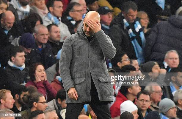TOPSHOT Manchester City's Spanish manager Pep Guardiola reacts during the UEFA Champions League quarter final second leg football match between...