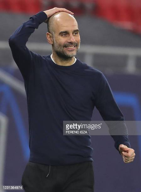 Manchester City's Spanish manager Pep Guardiola reacts from the sidelines during the UEFA Champions League, last 16, 1st-leg football match Borussia...