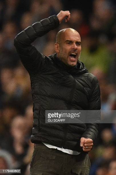 Manchester City's Spanish manager Pep Guardiola reacts on the touchline during the English Premier League football match between Manchester City and...