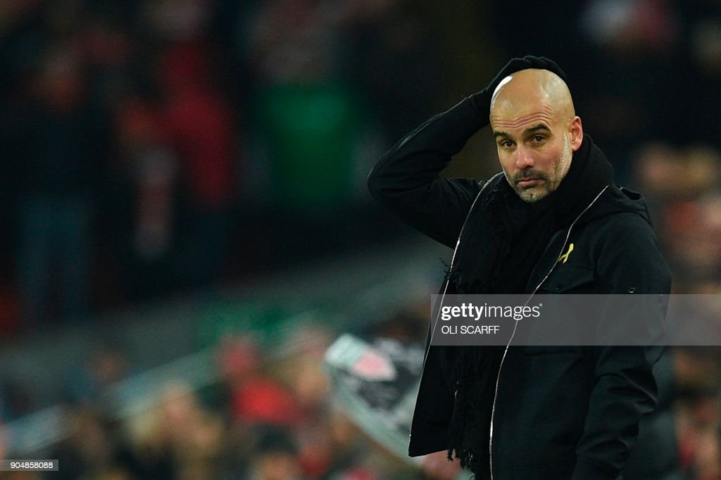 Manchester City's Spanish manager Pep Guardiola reacts on the touchline during the English Premier League football match between Liverpool and Manchester City at Anfield in Liverpool, north west England on January 14, 2018. / AFP PHOTO / Oli SCARFF / RESTRICTED TO EDITORIAL USE. No use with unauthorized audio, video, data, fixture lists, club/league logos or 'live' services. Online in-match use limited to 75 images, no video emulation. No use in betting, games or single club/league/player publications. /