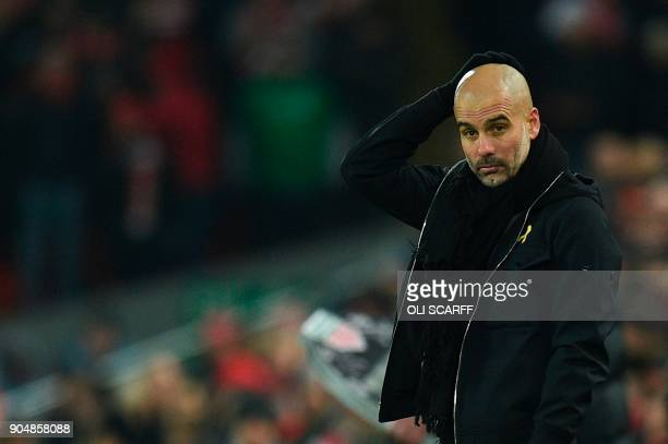 Manchester City's Spanish manager Pep Guardiola reacts on the touchline during the English Premier League football match between Liverpool and...