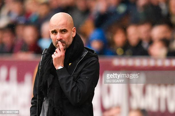 Manchester City's Spanish manager Pep Guardiola reacts on the touchline during the English Premier League football match between Burnley and...