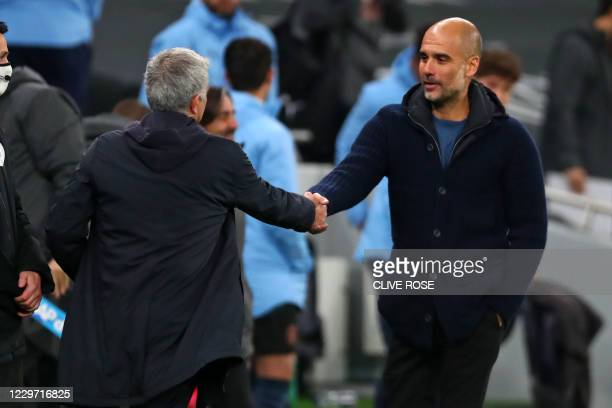 Manchester City's Spanish manager Pep Guardiola shakes hands with Tottenham Hotspur's Portuguese head coach Jose Mourinho during the English Premier...