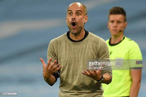Manchester City's Spanish manager Pep Guardiola shouts instructions to his players from the touchline during the UEFA Champions League round of 16...
