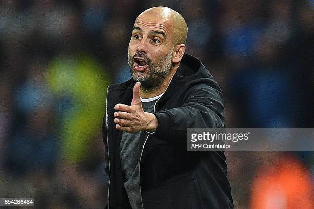 Manchester City's Spanish manager Pep Guardiola shouts instructions to his players from the touchline during the Group F football match between...