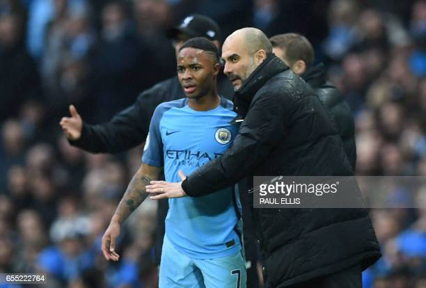 Manchester City's Spanish manager Pep Guardiola speaks with Manchester City's English midfielder Raheem Sterling during the English Premier League...