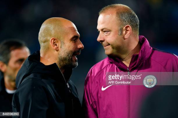 Manchester City's Spanish manager Pep Guardiola speaks with Manchester City's Spanish assistant coach Rodolfo Borrell after the UEFA Champions League...