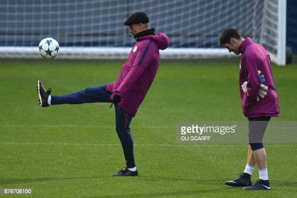 Manchester City's Spanish manager Pep Guardiola takes a team training session at the City Football Academy in Manchester north west England on...