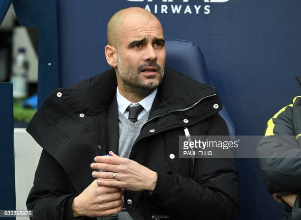 Manchester City's Spanish manager Pep Guardiola takes his seat ahead of the English Premier League football match between Manchester City and Swansea...