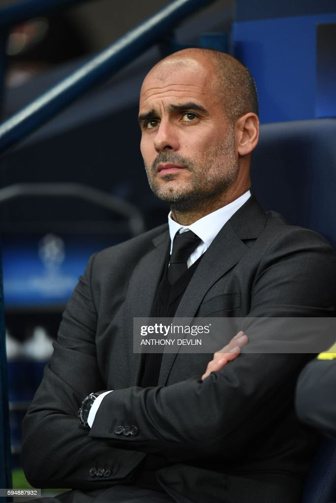 Manchester City's Spanish manager Pep Guardiola takes his seat for the UEFA Champions League second leg play-off football match between Manchester City and Steaua Bucharest at the Etihad Stadium in Manchester, north west England on August 24, 2016. / AFP PHOTO / Anthony Devlin