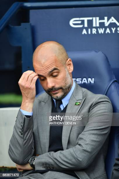Manchester City's Spanish manager Pep Guardiola waits for kick off of the English Premier League football match between Manchester City and West...