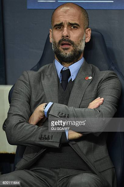 Manchester City's Spanish manager Pep Guardiola watches during the UEFA Champions League group C football match between Manchester City and Barcelona...