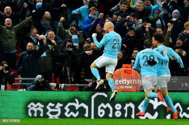 Manchester City's Spanish midfielder David Silva celebrates after scoring their third goal during the English League Cup final football match between...