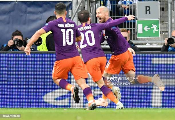 TOPSHOT Manchester City's Spanish midfielder David Silva celebrates scoring the 12 goal with his teammates goal during the UEFA Champions League...
