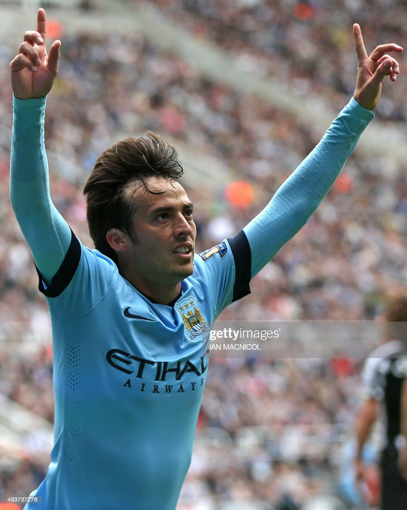 Manchester City's Spanish midfielder David Silva celebrates scoring the opening goal of the English Premier League football match between Newcastle United and Manchester City at St James' Park in Newcastle-upon-Tyne, north east England on August 17, 2014. USE. No use with unauthorized audio, video, data, fixture lists, club/league logos or live services. Online in-match use limited to 45 images, no video emulation. No use in betting, games or single club/league/player publications. / AFP PHOTO / Ian MacNicol