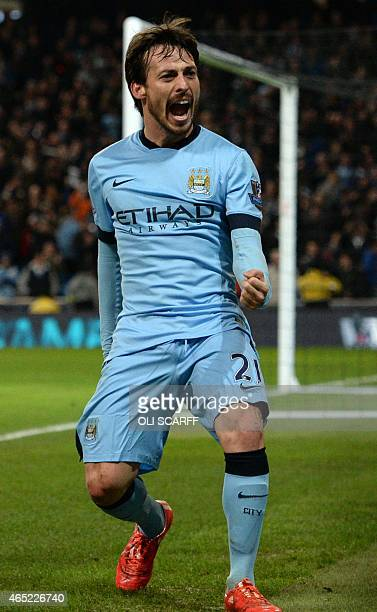 Manchester City's Spanish midfielder David Silva celebrates scoring the opening goal of the English Premier League football match between Manchester...