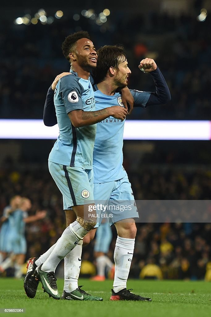 Manchester City's Spanish midfielder David Silva (R) celebrates scoring their second goal during the English Premier League football match between Manchester City and Watford at the Etihad Stadium in Manchester, north west England, on December 14, 2016. / AFP / Paul ELLIS / RESTRICTED TO EDITORIAL USE. No use with unauthorized audio, video, data, fixture lists, club/league logos or 'live' services. Online in-match use limited to 75 images, no video emulation. No use in betting, games or single club/league/player publications. /