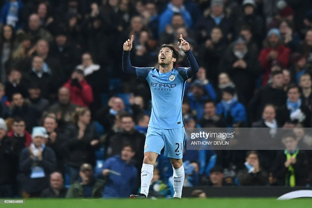 Manchester City's Spanish midfielder David Silva celebrates scoring his team's second goal during the English Premier League football match between Manchester City and Watford at the Etihad Stadium in Manchester, north west England, on December 14, 2016. / AFP / Anthony DEVLIN / RESTRICTED TO EDITORIAL USE. No use with unauthorized audio, video, data, fixture lists, club/league logos or 'live' services. Online in-match use limited to 75 images, no video emulation. No use in betting, games or single club/league/player publications. /