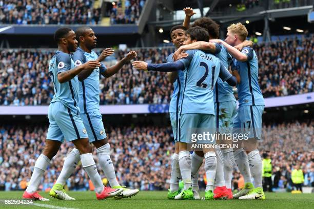 Manchester City's Spanish midfielder David Silva celebrates scoring the opening goal during the English Premier League football match between...