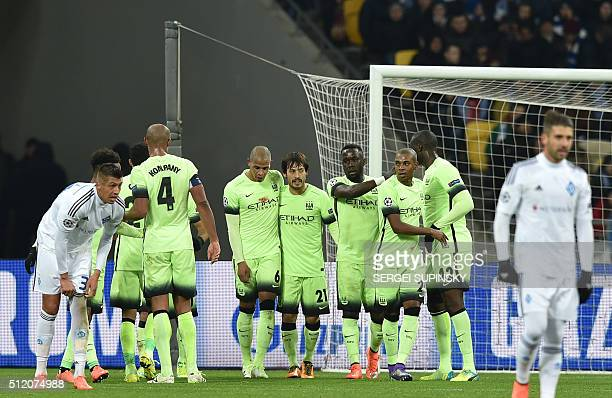 Manchester City's Spanish midfielder David Silva celebrates with his teammates after scoring during the UEFA Champions league round of 16 first leg...