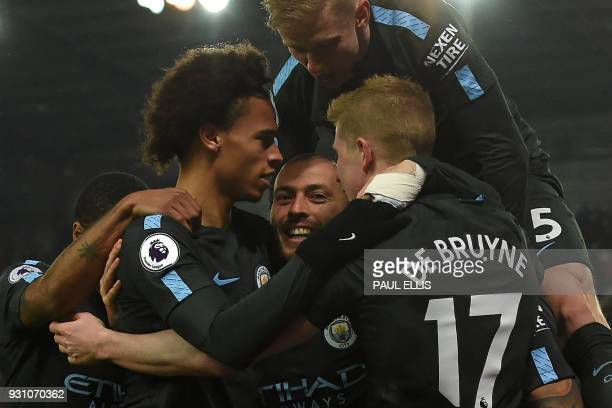 Manchester City's Spanish midfielder David Silva celebrates with teammates after scoring his second goal of the English Premier League football match...