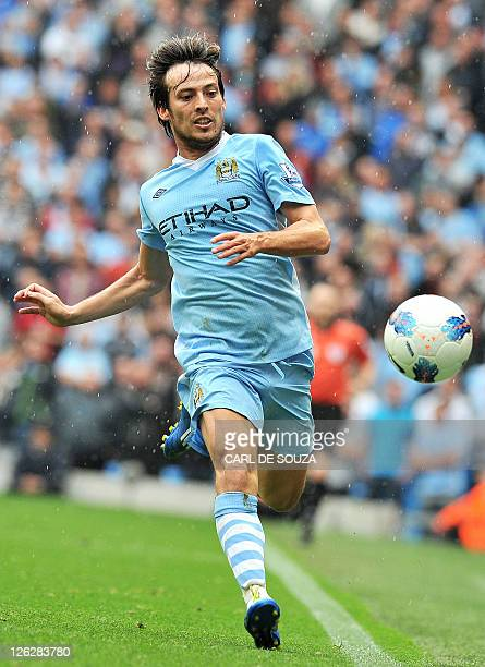 Manchester City's Spanish midfielder David Silva chases the ball during the English Premier League football match between Manchester City and Everton...